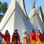 Native Americans in front of teepees