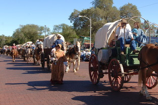 covered wagons on Main Street in Medicine Lodge during recent parade